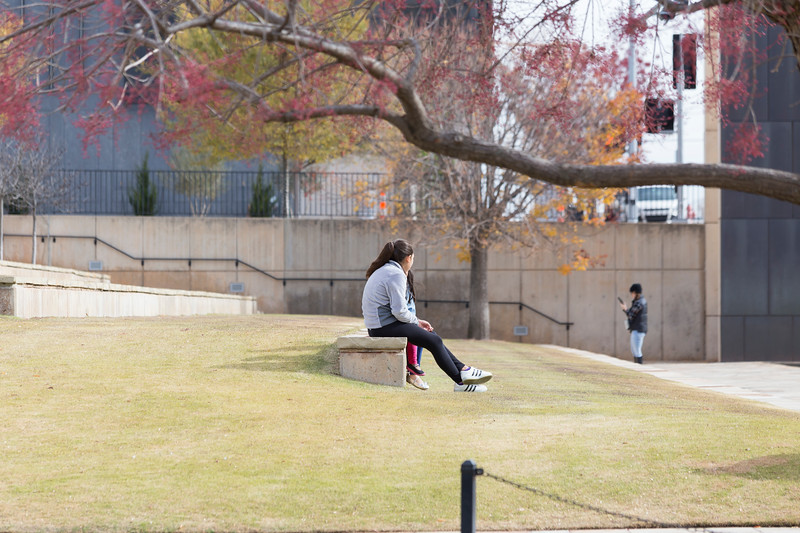 Two young girls sit and look out at the water feature at the Oklahoma Bombing Memorial Park on Tuesday, November 21, 2017 in Oklahoma City. (Emmy Verdin/Photographer)