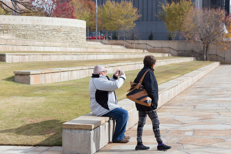 A couple takes pictures of the water feature at the Oklahoma Bombing Memorial Park on Tuesday, November 21, 2017 in Oklahoma City. (Emmy Verdin/Photographer)