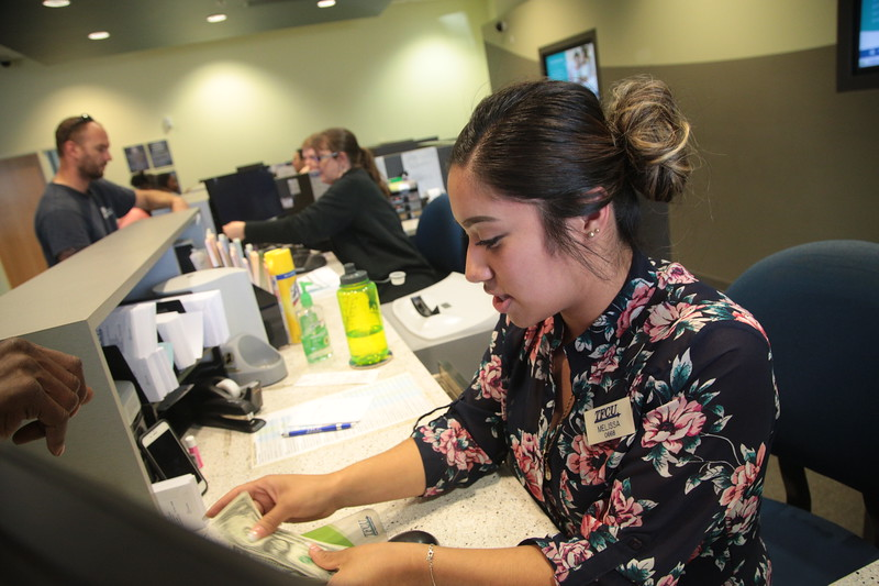 Melissa Gonzalez helps a member at Tinker Federal Credit Union located at 1177 NE 23rd St in Oklahoma City.