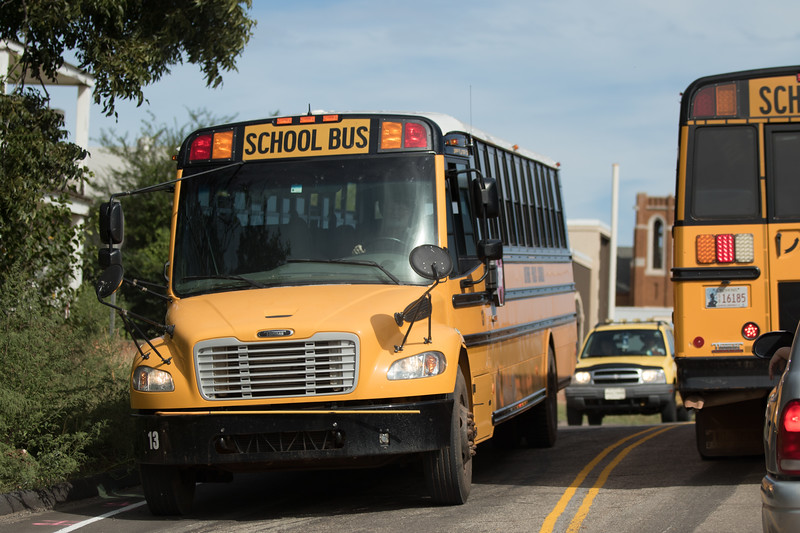 School buses taking students home in Guthrie, OK. Legislators have introduced measures to consolidate smaller schools into larger districts based on average daily attendence.
