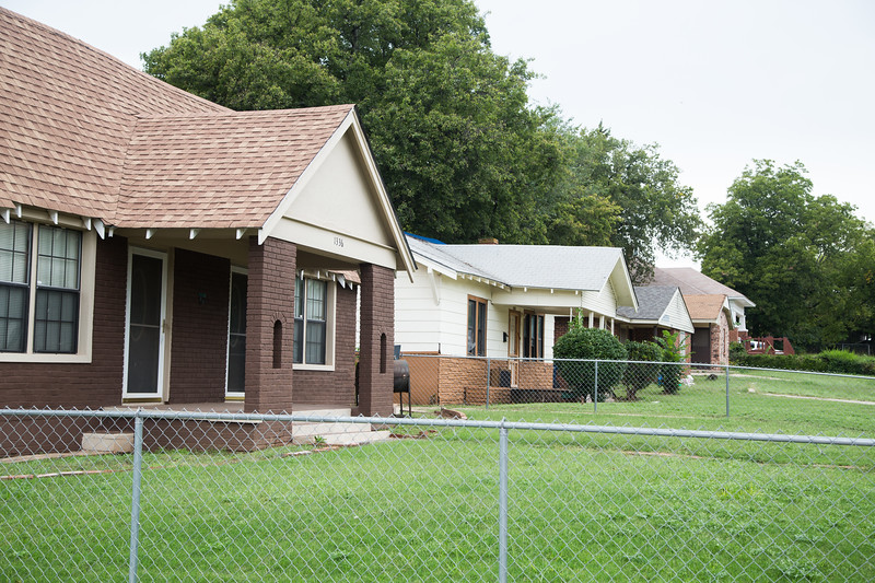 Vacant lots between homes in the JFK neihborhood in are being sold by the City of Oklahoma City.