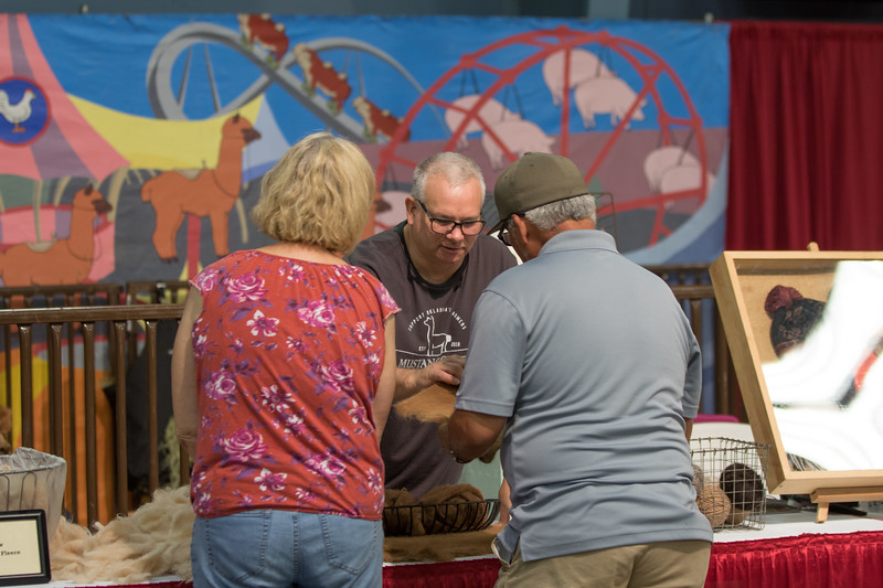 Mike Fleming at the Oklahoma State Fair showing products made with alpaca wool from Mustang Creek Alpaca Co. located in Mustang, OK.