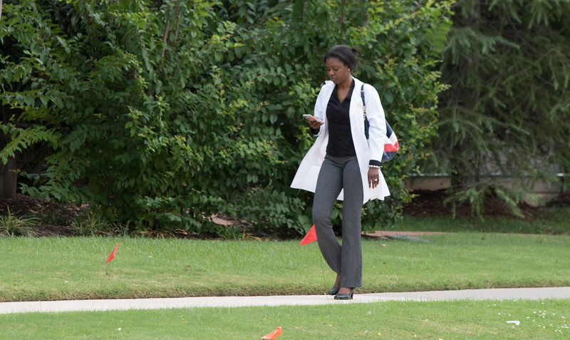 A doctor walking on the campus of OU Health Science Center in Oklahoma City, OK.
