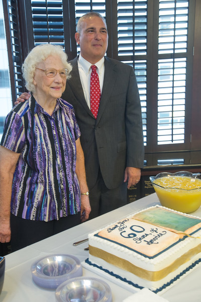 McAffee and Taft celibrated Betty Northcutt's 60th year at the law firm located in Oklahoma City. Managing Partner Mike Lauderdale acknowledged her years on the job with a party and gifts from the law firm.