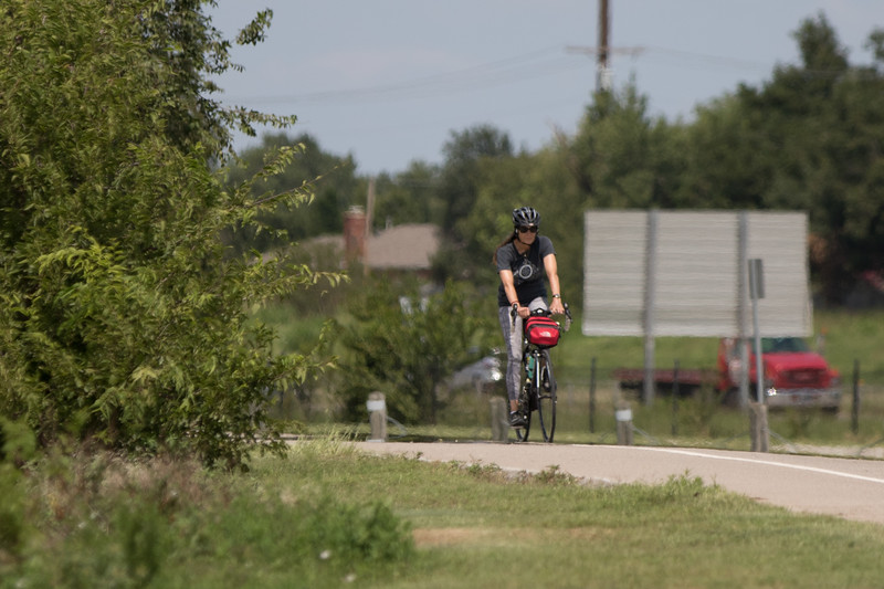 A bicyclist riding at Lake Hefner in northwest Oklahoma CIty.