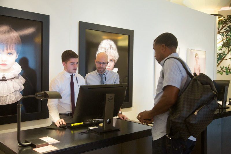 Tanner Gatlin checks a guest into 21c Hotel located at 900 W Main Street in Oklahoma City, OK.