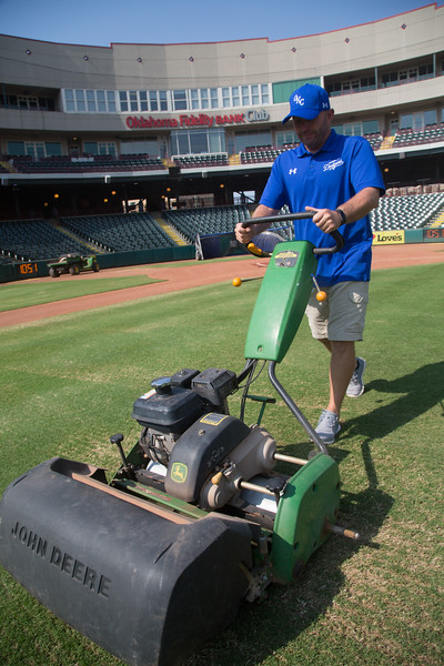 Head Groundskeeper Monte McCoy mowing the infield at the Bricktown Ballpark in Oklahoma City.