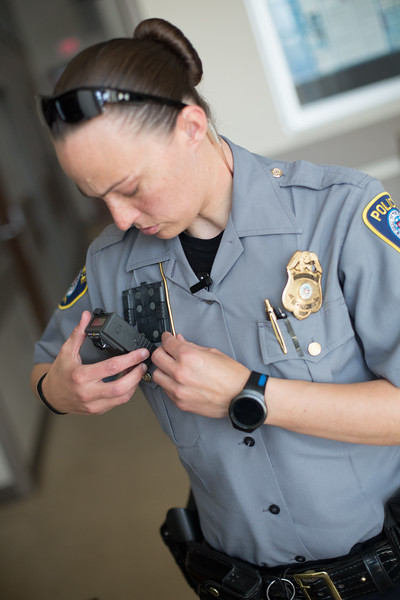 Oklahoma City Police Officer Elizabeth Brazell clips a body camera to her uniform before returning to duty.