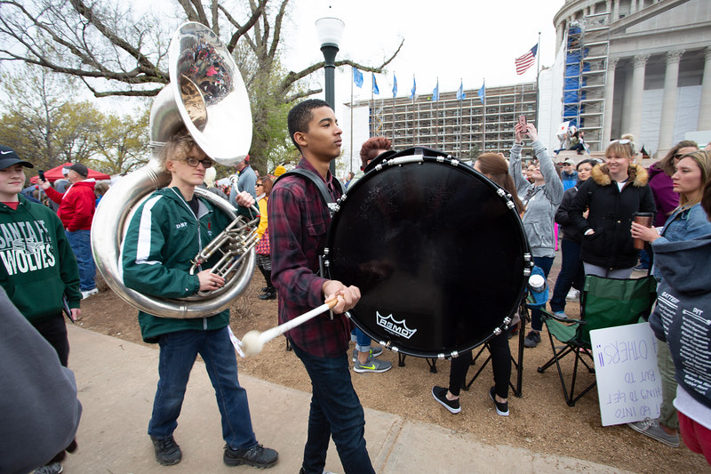 Students with Edmond Santa Fe High School march at the education protest at the Oklahoma State Capitol.