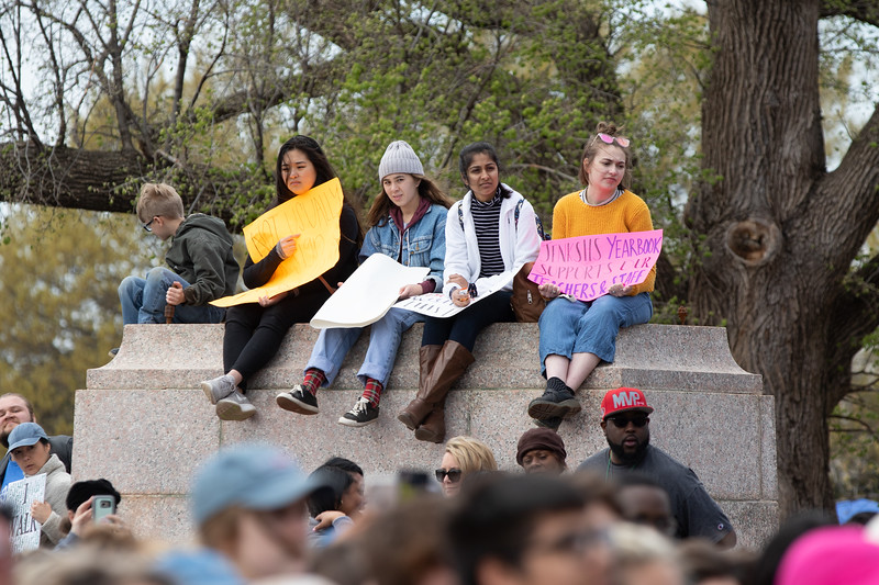 Protesters on an empty statue pedastel at the Oklahoma State Capitol.