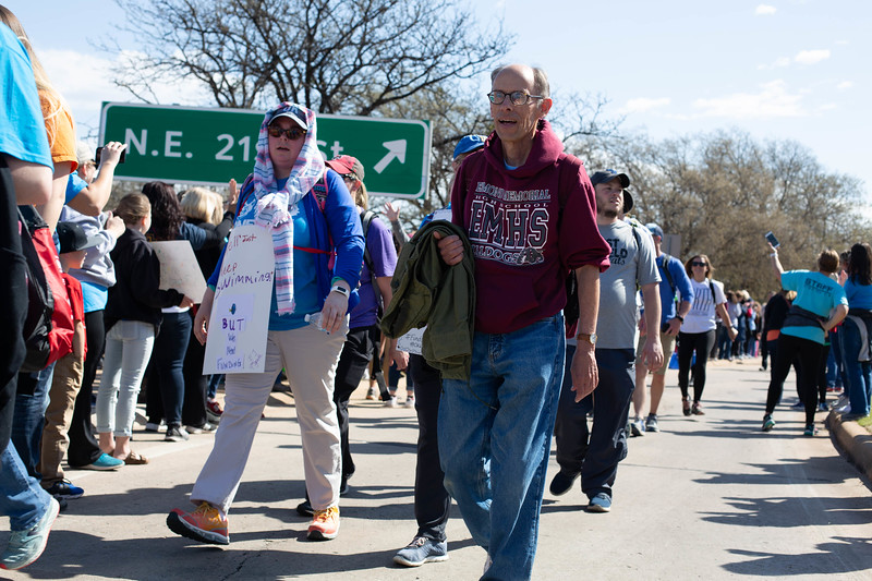 Teachers, students and parents arrive at the Oklahoma State Capitol monday morning after walking from the Edmond Public Adminastative Center in Edmond, OK.