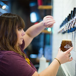 Eli Sisson pours a beer at Oak and Oar located in the Plaza District of Oklahoma City.