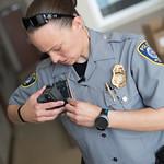 Oklahoma City Police Officer Elizabeth Brazell clips a body camera to her uniform before returning to duty.