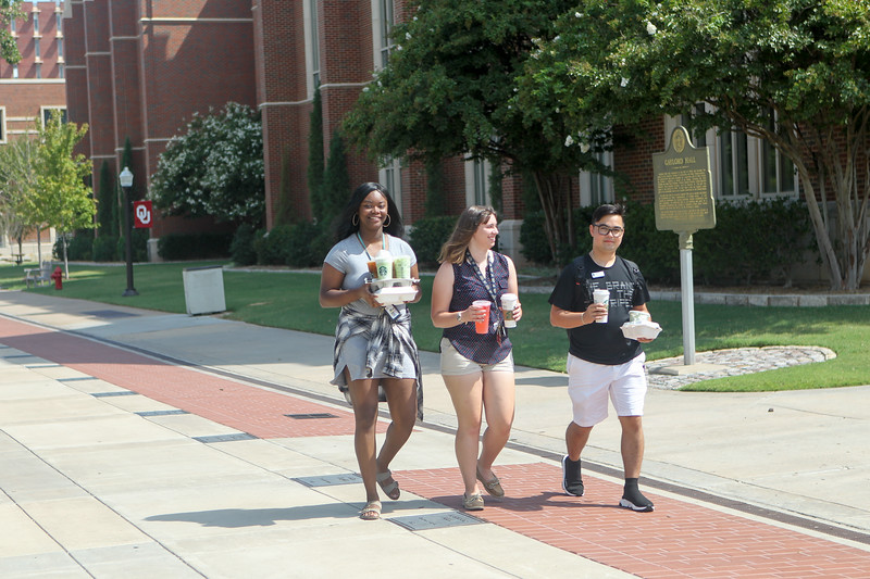Students walk past Gaylord Hall at the University of Oklahoma in Norman Wednesday, Aug. 9, 2018. (Journal Record/Jay Chilton)