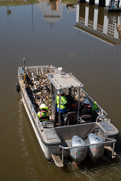 A garbage boat returns from picking up floating debris in the Oklahoma River in Oklahoma City.