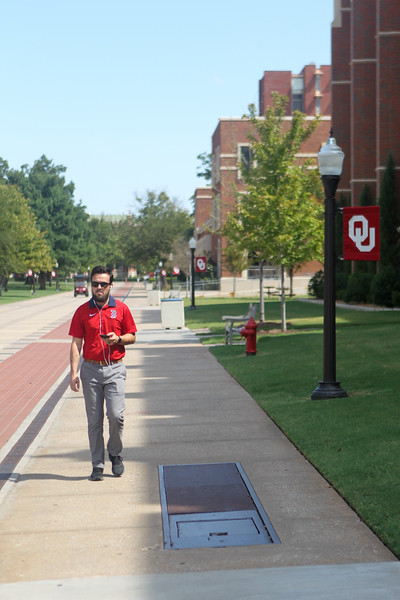 A student walks along the South Oval near Lindsey Street at the University of Oklahoma in Norman Wednesday, Aug. 9, 2018. (Journal Record/Jay Chilton)