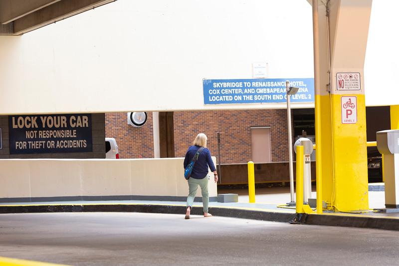A woman enters Santa Fe Parking Garage on Tuesday, August 14 in Oklahoma City.  (Emmy Verdin/Photographer)