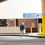 A woman enters Santa Fe Parking Garage on Tuesday, August 14 in Oklahoma City.  (Emmy Verdin/Photographer)