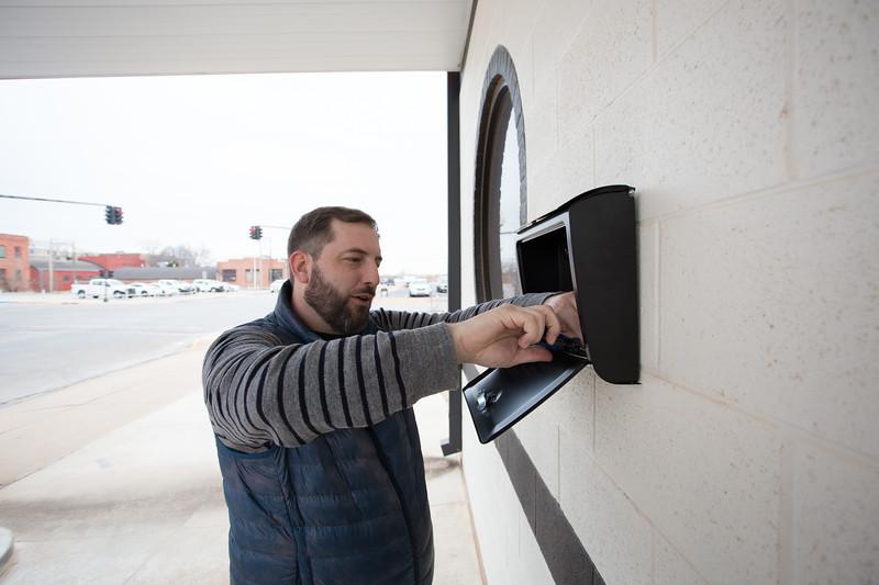 Drew Tekell installing a new mailbox at Prairie Wolf Vodka in Guthrie, OK.