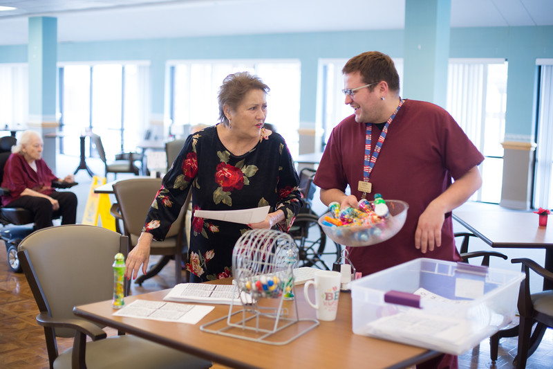 Activities Director Justin Gaudreau prepares bingo with the help of resident Wanda Vanderburg at Lakeside Nursing Home located at 5701 W Britton Ave in Oklahoma City.