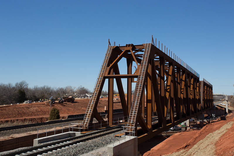 The new train bridge over I-235 in Oklahoma City has been installed and must pass incepction before the old bridge is demolished.