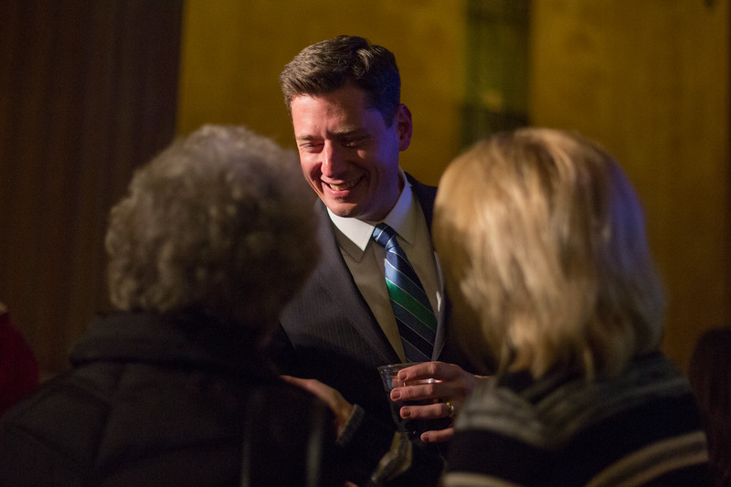 Mayorial canidate David Holt meets with voters at his watch party in the First National Center in downtown Oklahoma City.