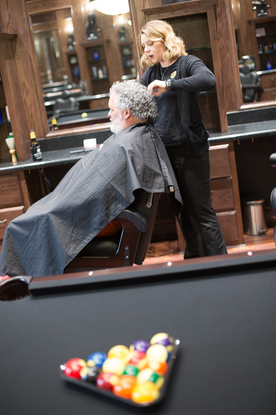 Macie Moss cuts a customers hair at The Boardroom Salon for Men at Classen Curve in Oklahoma City.