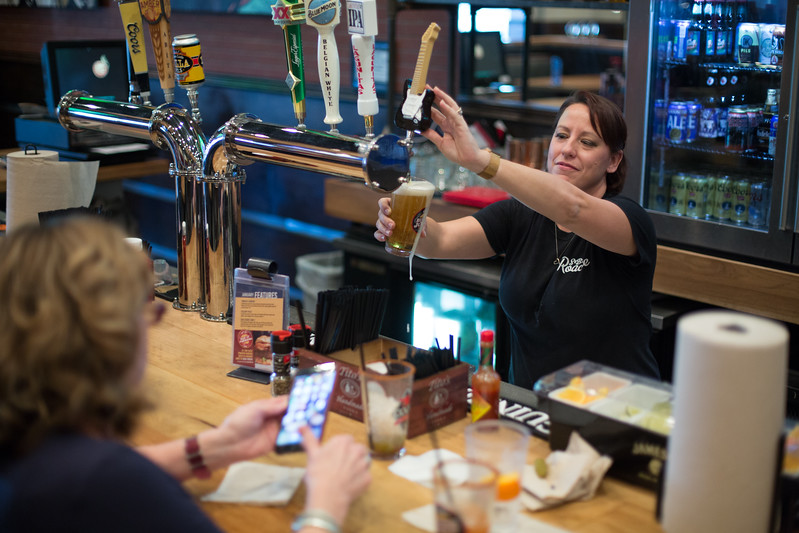 Belinda Reyff pours a beer at S&B Burger Joint located at 840 W. Danforth Rd. in Edmond, OK.