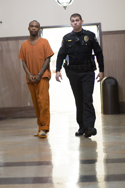 An inmate is escorted to court by a sheriff's deputy at the Oklahoma County Courthouse in Oklahoma City.