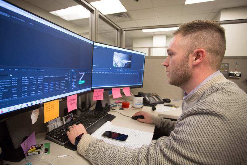 Caleb Everett editing video at the Greater Oklahoma City Chamber of Commerce located at 123 W Park Ave.