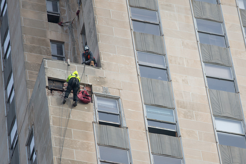Repair crews repel off the side of the First National Center in Oklahoma City. Over the weekend a peice of facade fell off damaging the Robinson Ave skywalk.