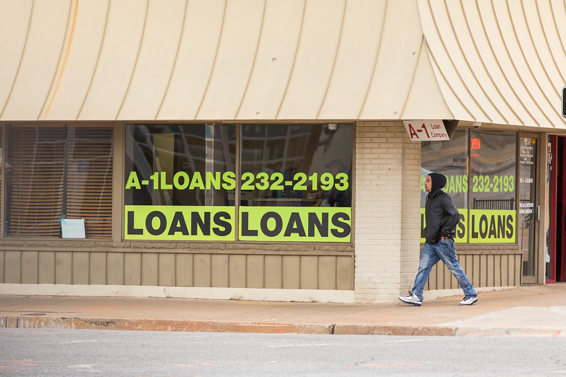 A man walking by A-1 Loans located at 331 NW 4th St in Oklahoma City.