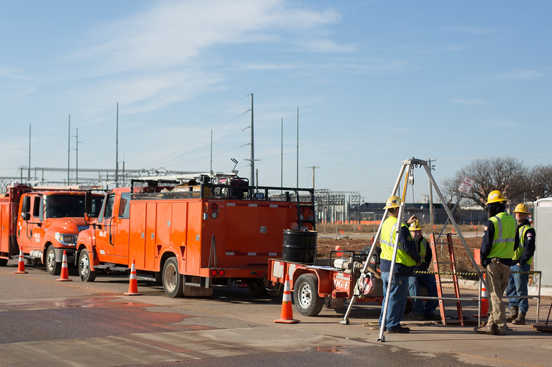 A crew with OGE works on underground power lines under SW 5th Street in Oklahoma City.