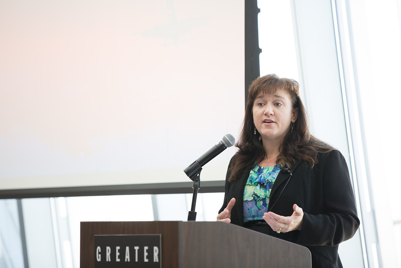 Michelle Coppedge, Director of the Mike Monroney Aeronotical Center, speaking at a Greater Oklahoma City Chamber of Commerce luncheon covering the FAA.