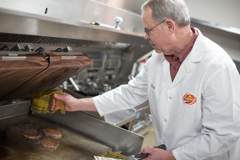 Steve Bobo prepares quarter pounds beef patties in the test kitchen at Lopez Foods located at 9501 W 4th Street in Oklahoma City.