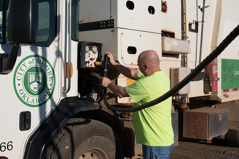 Duane Green refills his truck at the City of Moore's new natural gas instalation built by Sparq Natural Gas.