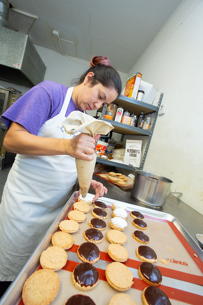 Sara Miller makes iced cookies at Confection Pastries and Coffee located at 213A SW 25th St in Oklahoma City.