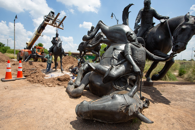 Deep in the Heart Art Foundry installs the 42nd piece of the Land Run Monument, located south of the Bricktown Canal. The monument commemorates Oklahoma territory being opened to settlers in 1889. There are three more statues still to be installed. When completed, the 45-piece monument will be one of the world's largest bronze sculptures.