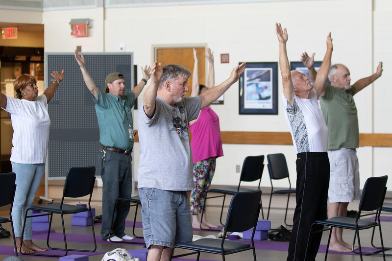 Veterns participating in a yoga class offered at the Oklahoma City VA Hospital.
