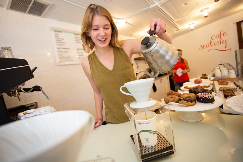 Anna Olson pours coffee at Holey Rollers located at 3010 Paseo Drive in Oklahoma City.