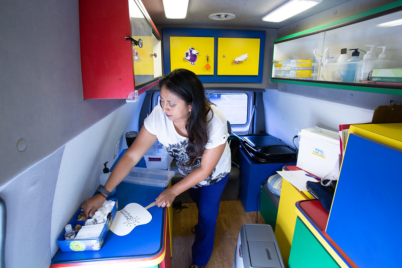 María Martinez, Caring Van Specialist, in a Blue Cross Blue Shield van that provides free immunization shots at various locations.