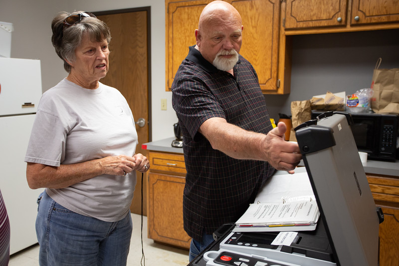 Ellen Duncan recieves voting machine training from Mike Wilson at the Oklahoma County Election Board in Oklahoma City.