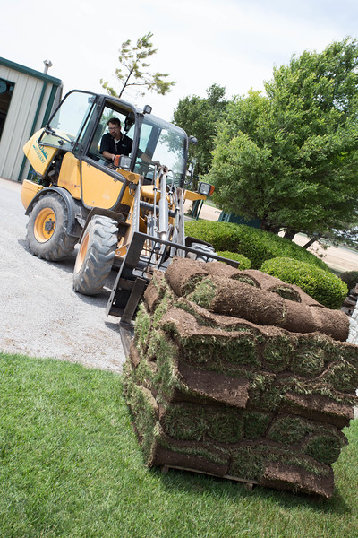 Brad Sherry places a pallet of sod at Sod by Sherry, Inc located at 17000 W Foreman Rd. in Yukon, OK.