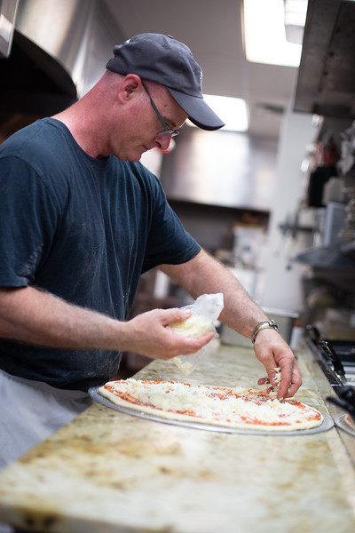 Owner Michael Jones makes a pizza at Wheelhouse Pizza opening soon at 11109 N May Ave in Oklahoma City.