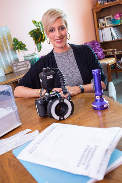 Karla Docter, Senior Legacy Officer at the YWCA Oklahoma City, with equipment used to gather evidence after sexual assult.