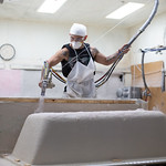 A bathtube being coated in fiberglass at Jetta Corporation located at 425 Centinnial Blvd in Edmond, OK.
