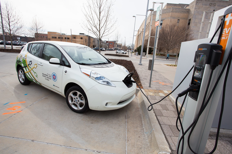 A electric car owned by the City of Oklahoma City charging in front of the Civic Center.