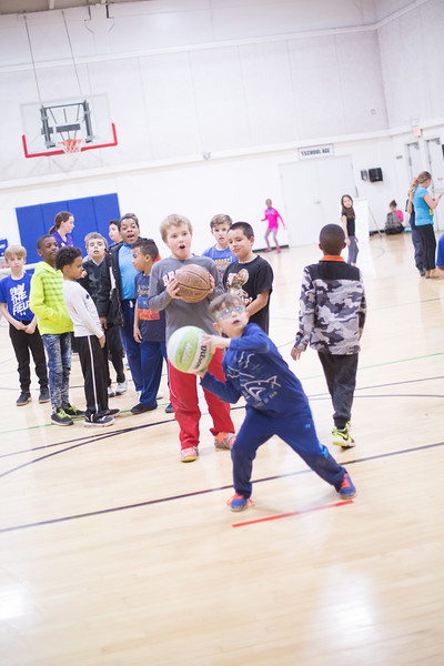 Kids line up to play basketball after school at the YMCA located at 1220 S Rankin St. in Edmond, OK.