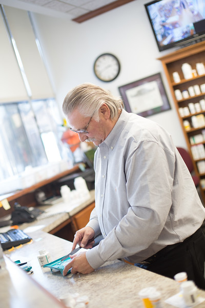 Pharmasist Mack Scherler fills a perscription at The Medicine Cabinet located at 211 N Robison Ave in Oklahoma City.