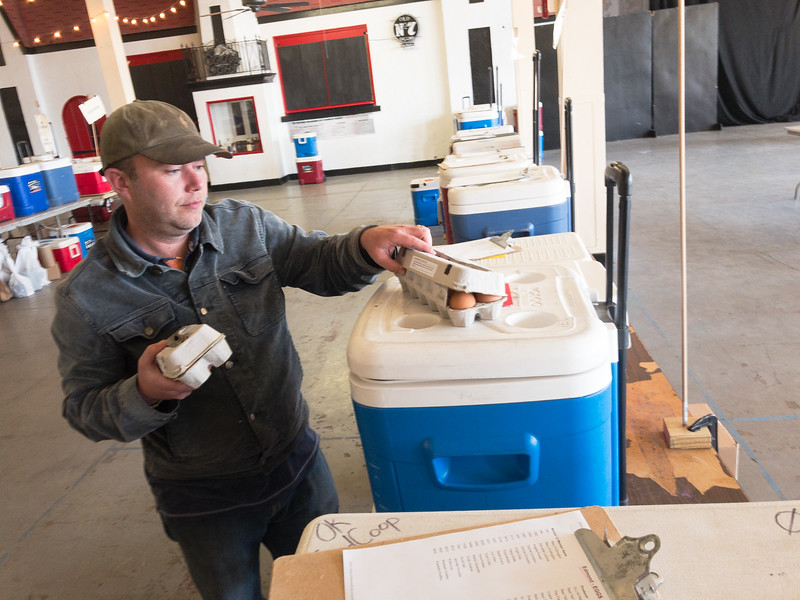 Dustin Green, owner of 10 Acre Woods in Norman, sorts eggs at the Farmers Public Market located at 311 S Klein Ave in Oklahoma City.